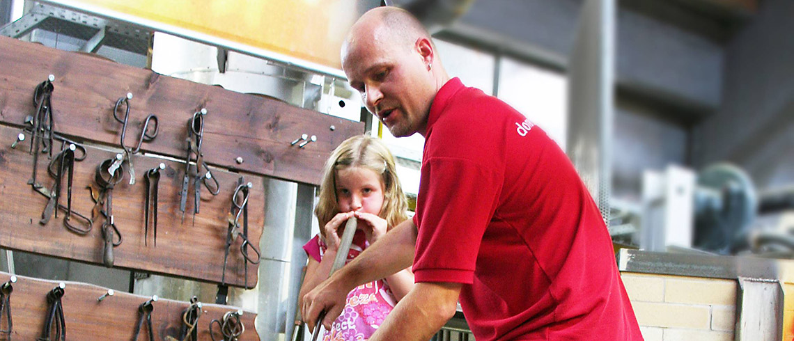Child doing glassblowing